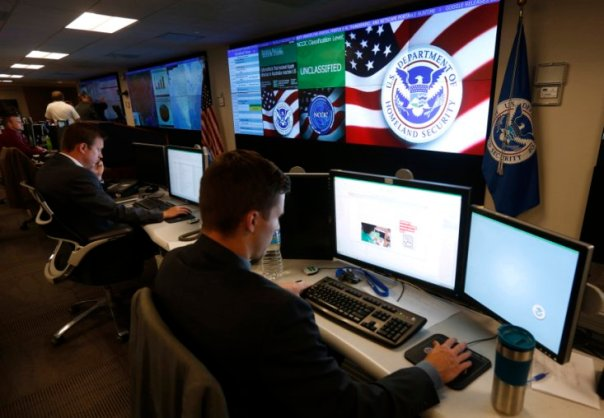 U.S. Department of Homeland Security employees work inside the National Cybersecurity and Communications Integration Center in Arlington